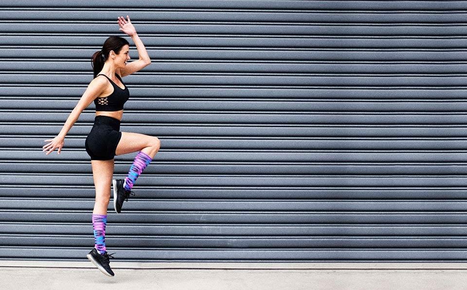 Active woman wearing colourful Lightfeet Predator socks